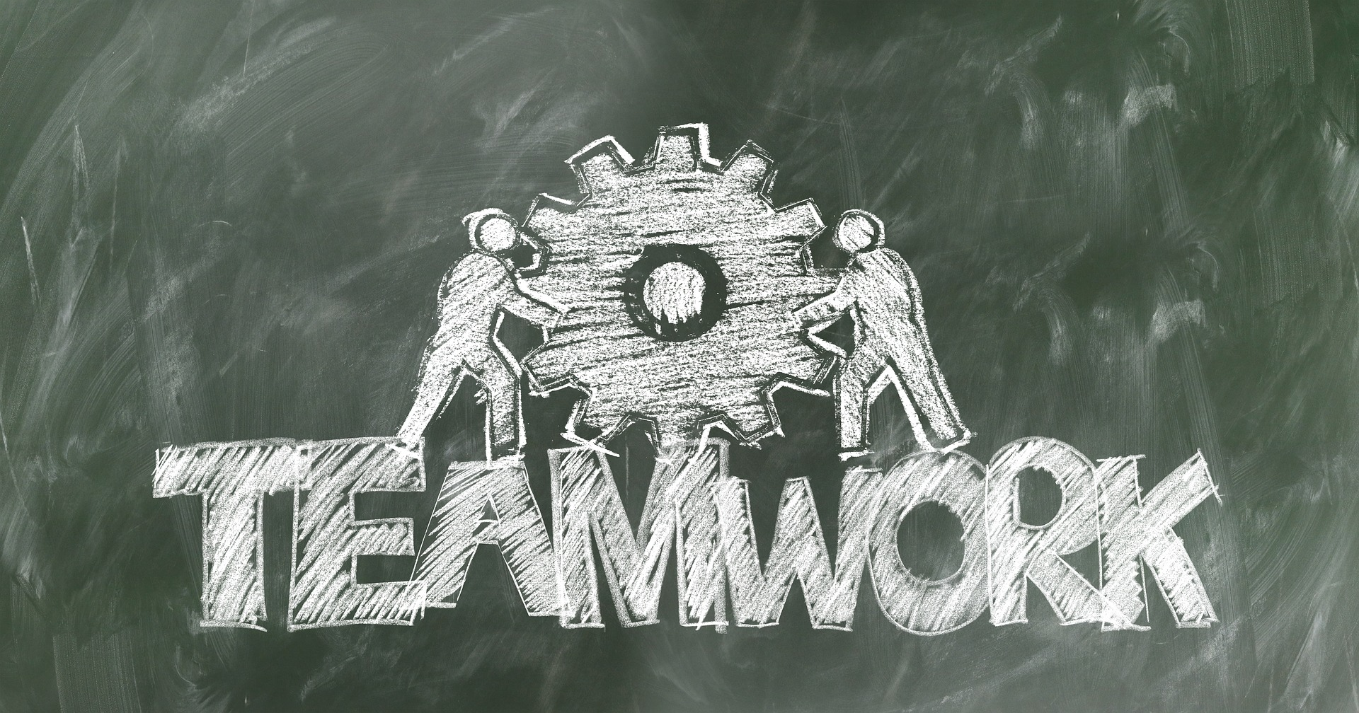 immagine disegnata alla lavagna che rappresenta il lavoro di gruppo